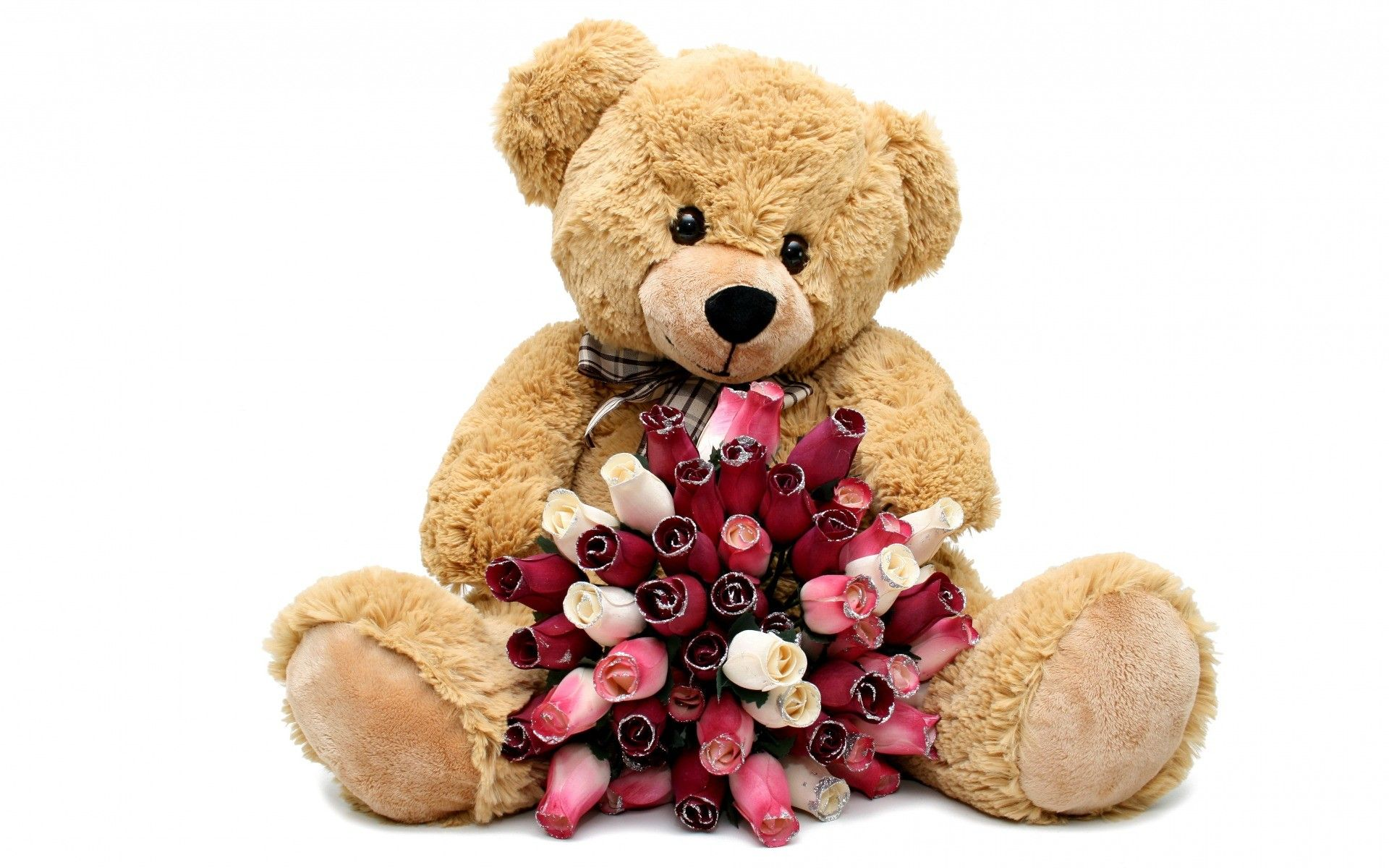 toy bear with bouquet of red roses