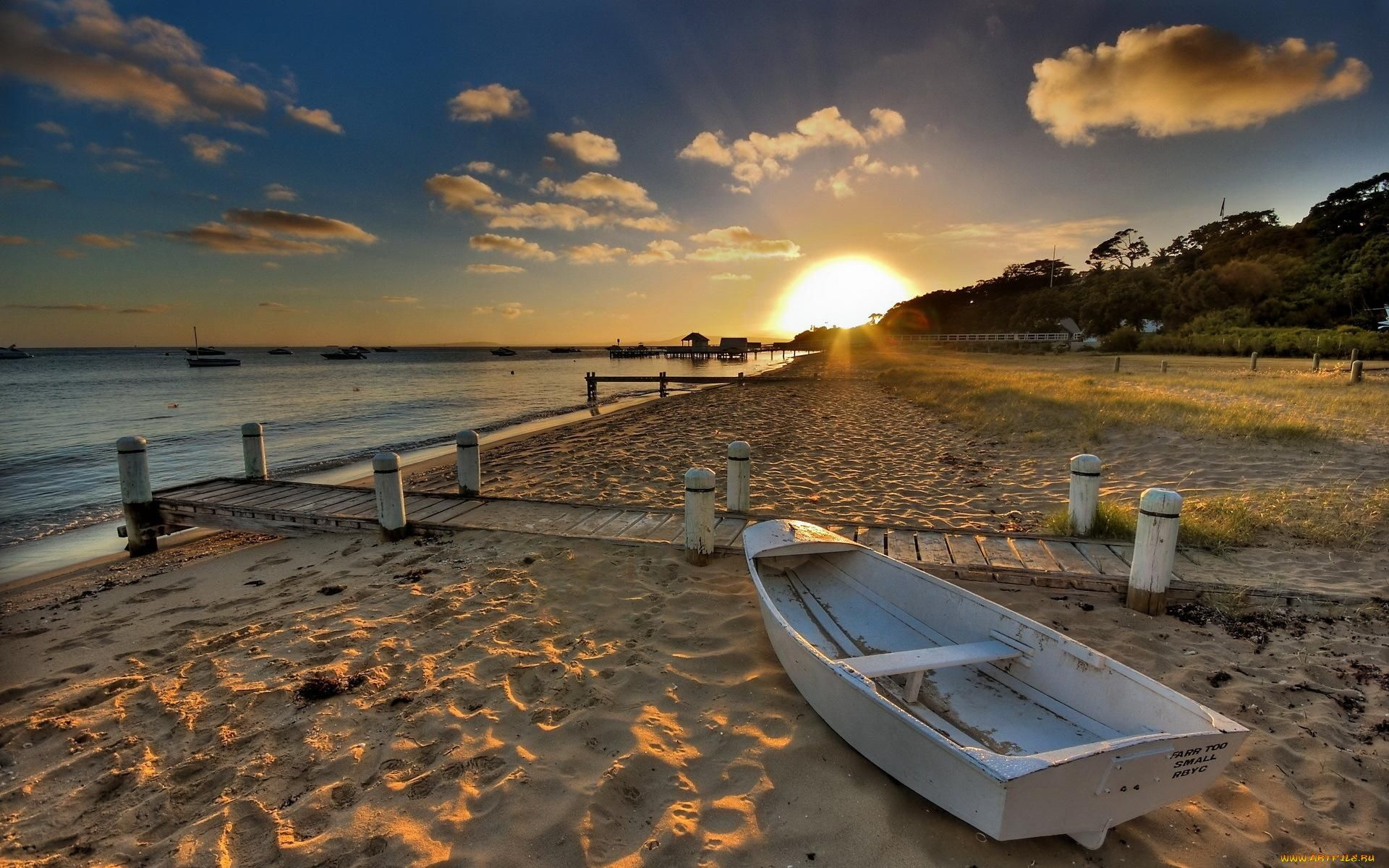 sun and boat on the beach wallpaper