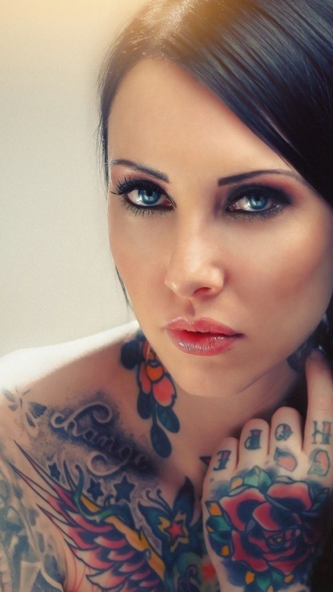 Blue Eyed Tattooed Brunette Wallpaper
