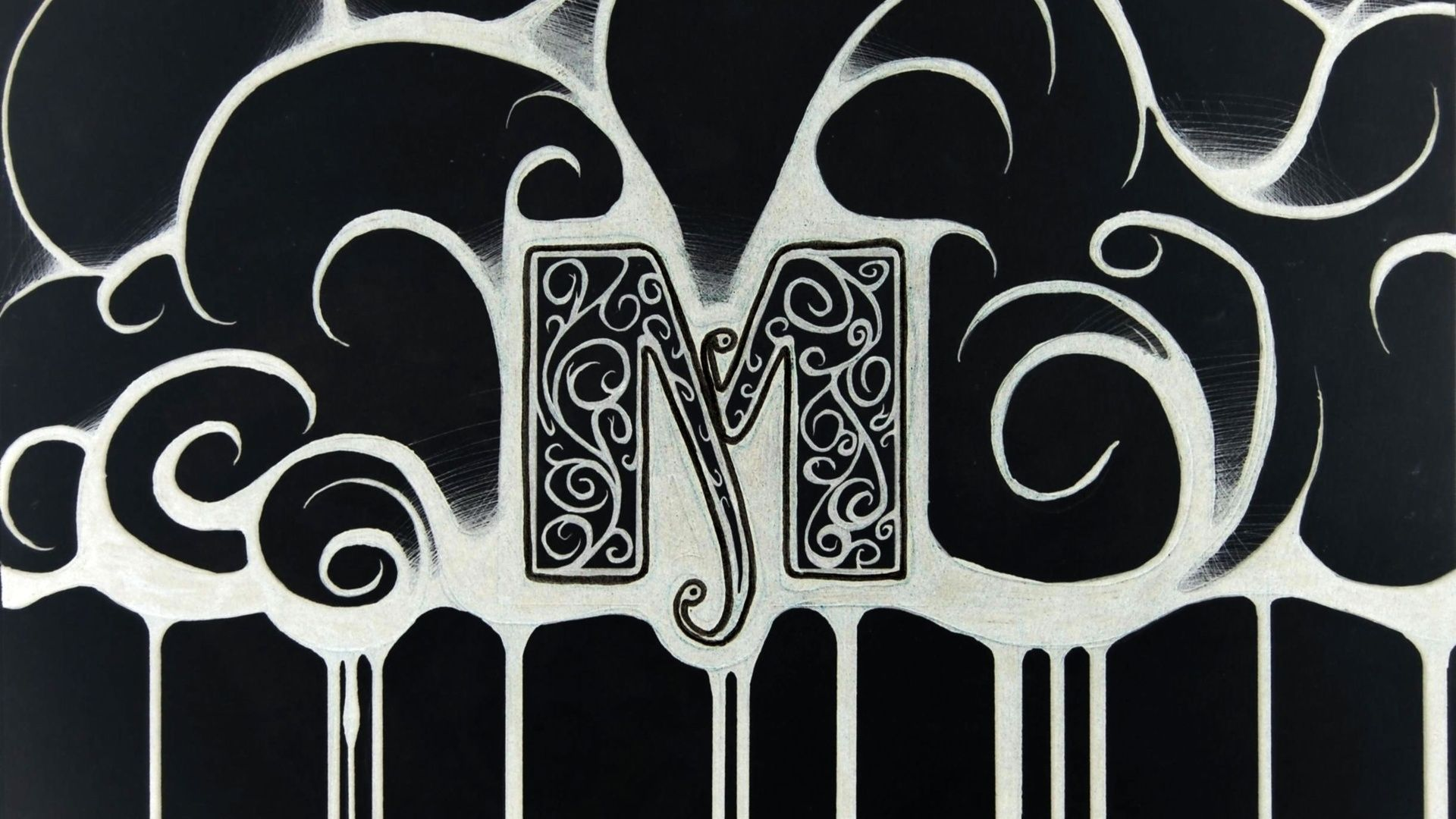 Beautiful Letter M On A Black Background