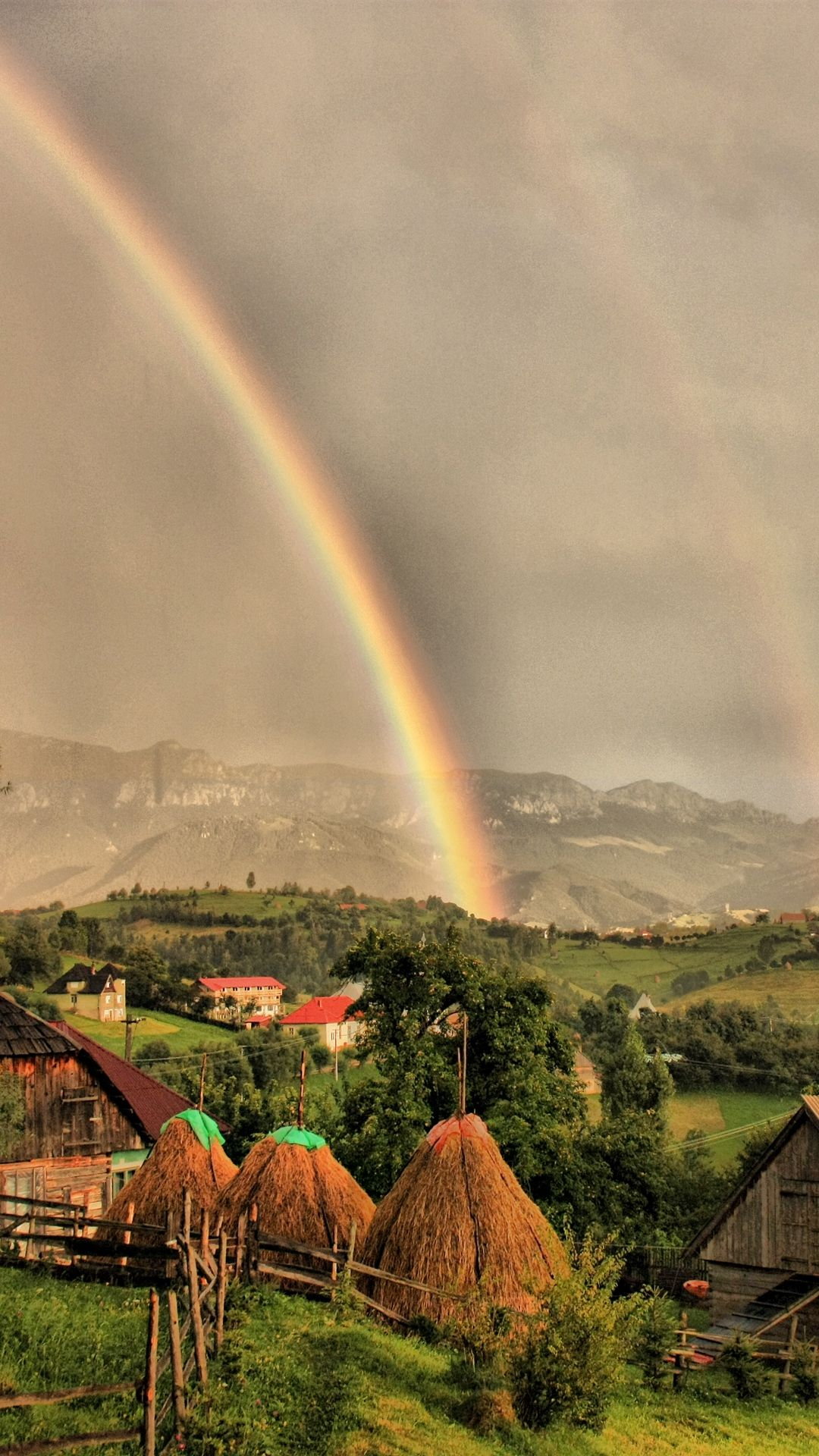 Rural Landscape With Rainbow