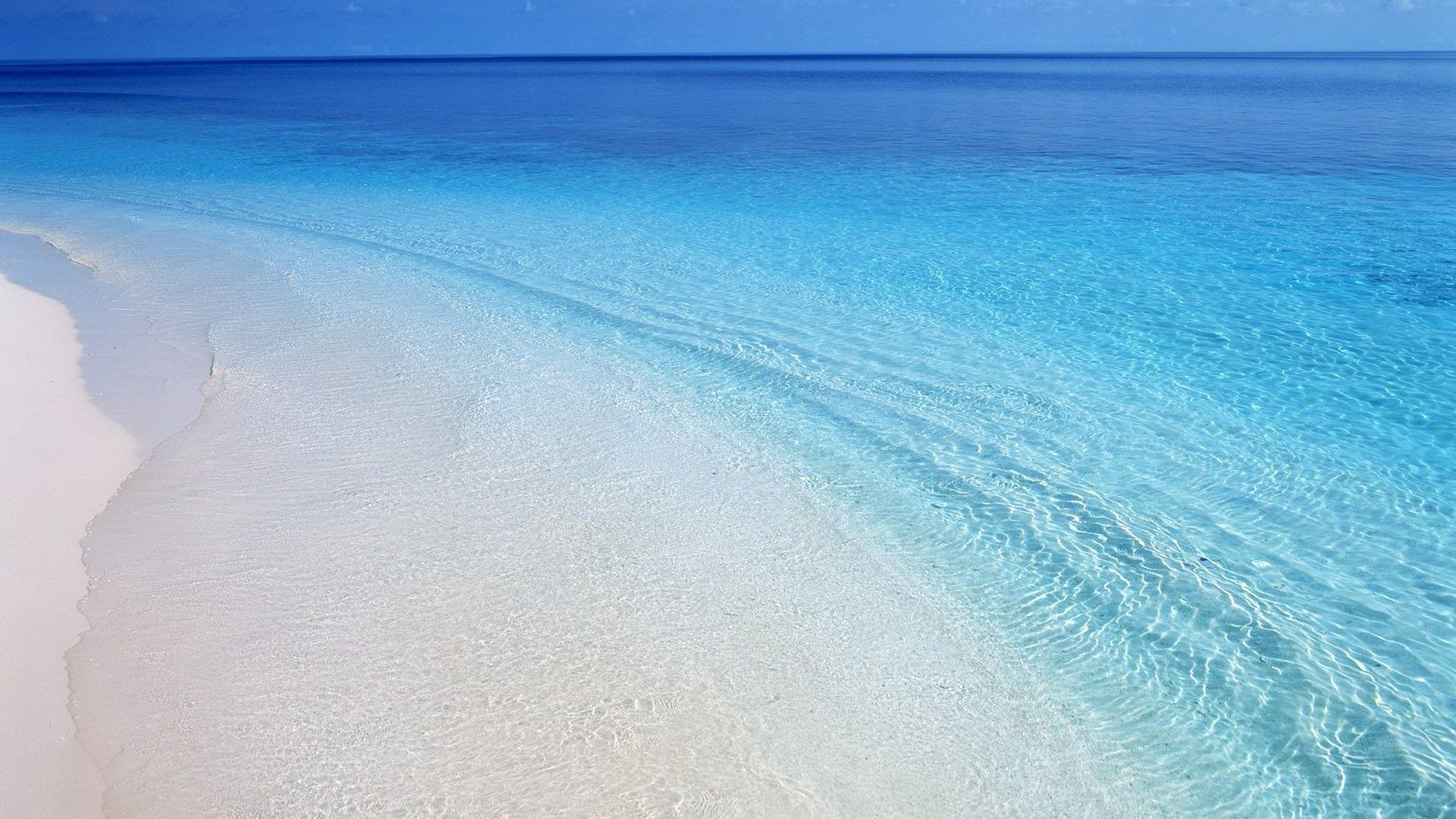 Turquoise Sea And White Sand