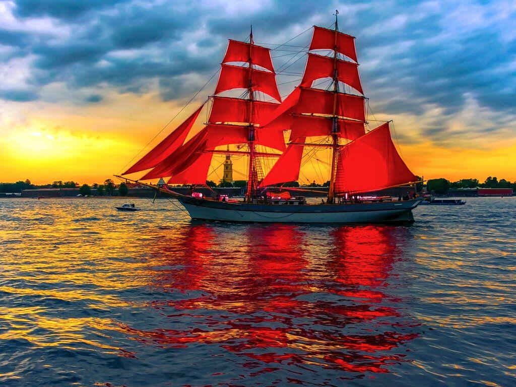 Photo Of A Sailboat At Sea