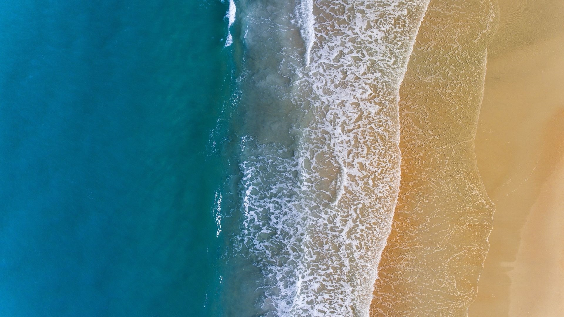 Sea ​​and Sand From Above background wallpaper